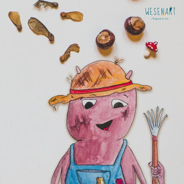 WESENsART – Loui liebt Gartenarbeit, hier zu sehen mit Hut und Harke