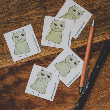 5 Wesen kleben rum, zum Beispiel in Grün.
