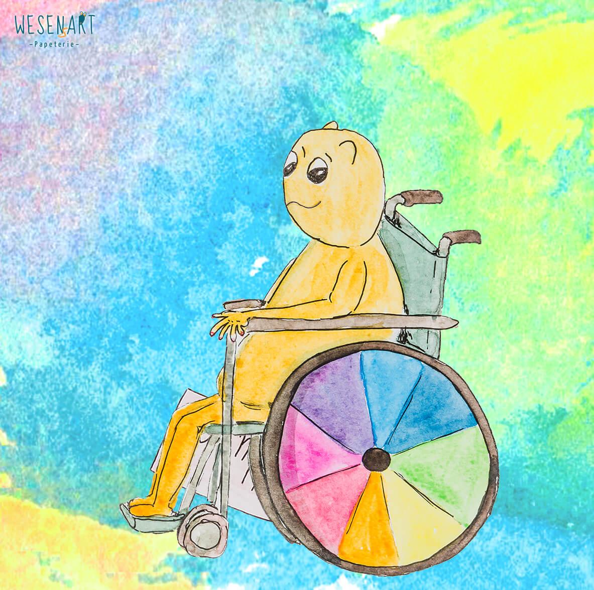 Luca sitzt im Rollstuhl. Der Reifen hat einen Regenbogen-Fächer im Reifen.